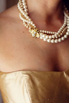 I LOVE this!!! Our favor is honey!!! Bees were part of the theme, so she had a pearl necklace for each bridesmaid with a bee on it... Easy to make. You just use a brooch.
