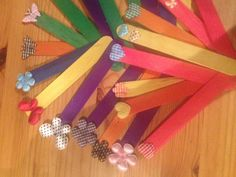 Simple but pretty bookmarks made from kids craft sticks and embellishments