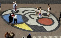 Spanish painter Joan Miro's huge ceramic mural decorates the pavement in the 'Ramblas' in Barcelona