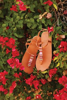 Exquisitely crafted from the finest African leathers, the Sseko T-Strap Sandal allows you to easily mix up your look by simply swapping out the accent piece! The best part? Every sandal helps send a girl to college.