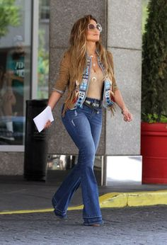 J-Lo was spotted giving off a 70's vibe on the set of her new music video El Mismo Sol. image found on:http://fashionbombdaily.com/2015/08/25/fabulous-looks-of-