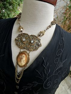 """Rustic Gypsy Creations. Etsy store. Love the artist work!! """"This lovely statement piece is crafted of several antique elements. The focal is comprised of a french art nouveau half buckle and celluloid"""