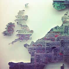 DIY inspiration -- map made from bus/train tickets -- save the tickets from your trip, paste onto a map, cut out along the continent edge, frame and hang.