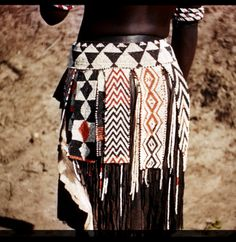 Africa | Close-up of beaded leather skirt of Hambukushu woman (Mbukushu, San people), near South Okavango River, Bechuanaland (Botswana) | 1951, photographed by Thomas John Larson