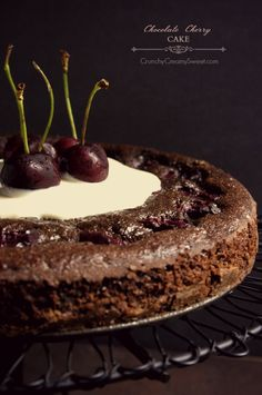 Chocolate Cherry Cake - This cake is a go between brownies and a simple chocolate cake. Yet it's not just a cake. It's moist, it's full of chocolate pieces and sweet dark cherries. Heaven in your mouth!!