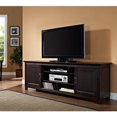 Have to have it. Walker Edison 70 in. Wood TV Stand with Sliding Doors - Espresso - $549 @hayneedle.com