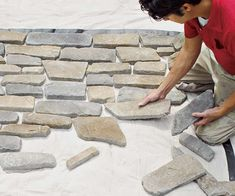Stone veneer installation tip: lay out stone design on ground before installation