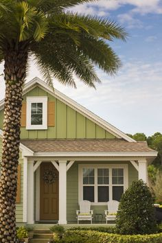 2010s: The New Cottage:  While neutrals reign,interesting color is making a creeping comeback. Particularly popular aredeep hues that emphasize deserving architecture,as in this sagecottage accented with sunflower yellow. Butit's not just color that can define a house:Here, HardiePanel® vertical siding and HardieTrim® batten boards help draw the eye tofeatures (hello, cute front porch), that make this home so sweet.