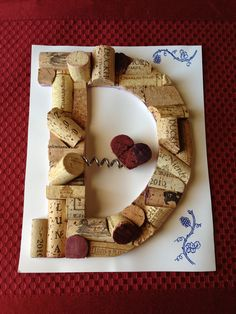 My husband made this for me out of our saved wine corks. The wine screw opener is the special touch.