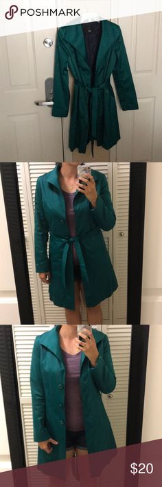 Teal trench coat Very lightweight. Used as a jacket for a few evening occasions. Looks like satin, actually a blend of cotton/polyester/spandex.  And yes, it has pockets! Mossimo Supply Co. Jackets & Coats Trench Coats