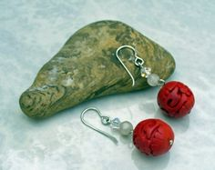 Carved cinnabar drop earrings  $17