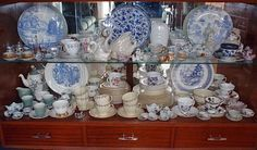 Crown Lynn blue & white dinner plates on display in china cabinet