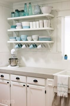 Concrete counters with white cabinets