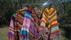 Beautiful vibrant multi coloured hand knitted ponchos some with hats some without . gorgeous colours made with love by the Artisans from the villages of Nepal. Australian Design Nepalese made . Unique in Design . Each Poncho individual colour..