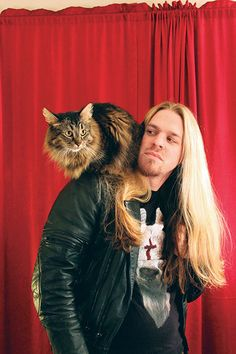 Real Metalmen Love Cats: An Oakland-based photographer pairs heavy metal musicians with kitty cats. BY LINDA LENHOFF