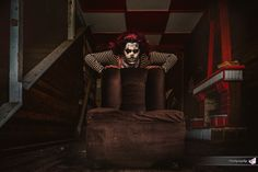 #clown #creepy #halloween #photography #red_white #chess #couch #brown #fireplace  #stairs #wooden_walls #wood #black_and_white #stripes #red_hair #evil_smile