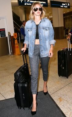 Gigi Hadid accessorized fitted sweatpants and a crop top with a jean jacket, pumps and jet black aviator sunnies!
