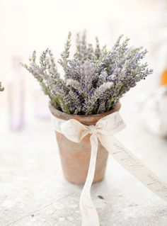 A simple lavender table accent...perhaps for place settings or add a table number on a stick for wedding receptions