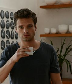 """""""I'd offer you coffee... But I don't drink it."""" He told her nonchalantly as he sipped from his cup of water."""