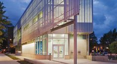 The Watha T. Daniel/Shaw Library, a sleek, glass-enclosed structure in DC's Shaw neighborhood that juts out above visitors as they enter. #architecture #design
