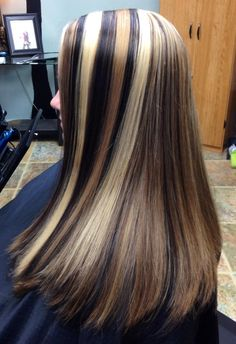 High impact platinum, caramel, and soft black highlights and lowlights. See salemoregonhairsalon.com for more examples.