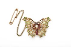 A La Vieille Russie| Fancy-colored Diamond and Ruby Antique Butterfly Brooch | - FABERGE, Antique Jewelry, Russian Art, Antiques, Gold Snuff Box Dealers ALVR New York, NY|