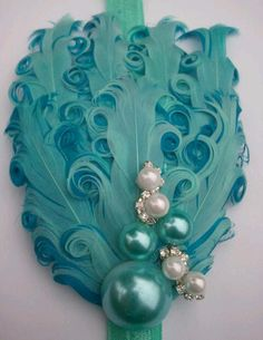 Ocean Bubbles pale aqua blue and turquoise nagorie feather fascinator headband- lovely for girls, teens, ans women. $14.50, via Etsy.