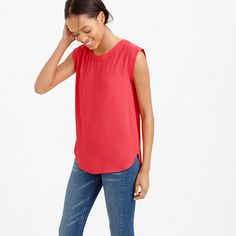"Inspired by a classic tomboy tank but <i>much</i> chicer, thanks to the clean lines and drapey fabric. <ul><li>Body length: 27"".</li><li>Poly.</li><li>Cap sleeves.</li><li>Machine wash.</li><li>Import.</li></ul>"