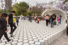 DESIGNBOOM: wave of buckets floods mextropolis architecture festival in mexico city http://www.davincilifestyle.com/designboom-wave-of-buckets-floods-mextropolis-architecture-festival-in-mexico-city/     flooding the central alameda park in mexico city, factor eficiencia and 5468796 architecture creates a wave of buckets as a symbol for the liberation of public spaces in the metropolis. the 100.0 m² temporary pavilion uses common painter's buckets as its building blocks,
