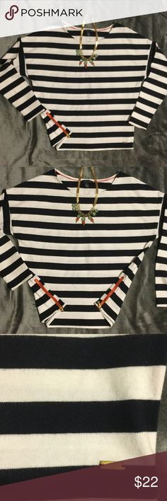 Tommy Hilfiger stripe top size M White and blue/black stripe top has side zipper detail. The neckline is a boatneck style and the shoulders are a drop shoulder detail. Made from 200% cotton. Underarm to underarm 20 inches. Shoulder to bottom of garment 22 1/2 inches Tommy Hilfiger Tops