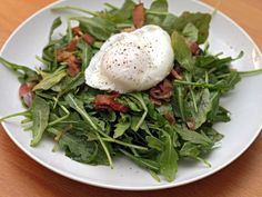 The Lyonnaise Salad is a classic combination featuring aggressively flavored greens (frisee is traditional), crisp-tender bacon, a vinaigrette made from the bacon fat, plenty of black pepper, and a soft poached egg. As salads go, it sounds pretty decadent—and delicious. This version from Michael Ruhlman's fantastic recent cookbook Ruhlman's Twenty uses peppery arugula for the greens.\n