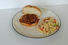 Dr. Spicy BBQ pulled pork sandwiches are made in the crock-pot so you don't have to turn on the oven!  Perfect for Labor Day picnics!