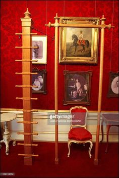 A Museum Is Devoted To Empress Sissi In Hofburg Palace. On May 1, 2004 In Vienna (Austria), Austria. Furniture Used By Sissi To Practise Physical Exercises. In The Background, Portraits Of Her Family.