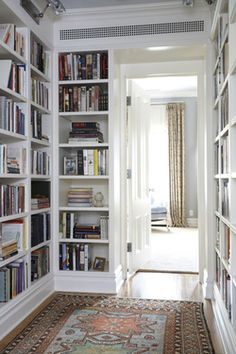 Why let a blank hallway go to waste when you can line it with your favorite literature? | Design by Coburn Architecture