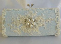 Cover and old clutch with lace and old earring = Pale blue vintage clutch!