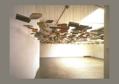 Richard Wentworth's installation in London's Lisson Gallery features hundreds of books suspended by string