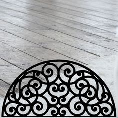 This decorative Wrought Iron Wall Art piece, Style 198, features a Geometric half circle silhouette perfect for displaying over a door, window or mantle. It is coated in one of the most long-lasting finishes available - a flat black baked-on powder coated finish that will last for many years. Wrought Iron Wall Art, Mantle, Half Circle, Tile Floor, Art Pieces, Wall Decor, Display, Powder, Silhouette