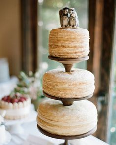 Charleston Crêpe Company honored the groom's French heritage by creating a three-tiered unfrosted crêpe cake for his wedding.