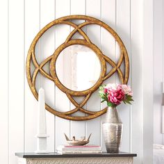"Dimensions: 34""dia. x 1""d   Great conversation piece   Lightweight resin frame to hang anywhere   Adds light and shineProof that a mirror can be a knockout focal point, this circular mirror is set in a unique looped frame reminiscent of a Celtic knot. Adds the elegance and shimmer of hand-painted gold with the shine of mirrored glass. Hand-cast in lightweight resin, so it's easy to hang anywhere."