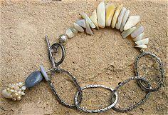 SERIES- Desert Chic Collection  TITLED - Waltzing Matilda  STONE - Coober Pedy Handcut Black Opals  METAL- Sterling Silver ORIGIN- Australia