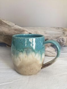 Wheel thrown pottery mug made by me. Glazed in 'Cocoa Mint'. Turquoise green and taupe. Wheel thrown pottery mug made by me. Glazed in 'Cocoa Mint'. Turquoise green and taupe. Pottery Shop, Slab Pottery, Glazes For Pottery, Pottery Mugs, Handmade Pottery, Pottery Studio, Ceramic Pottery, Glazed Pottery, Handmade Ceramic