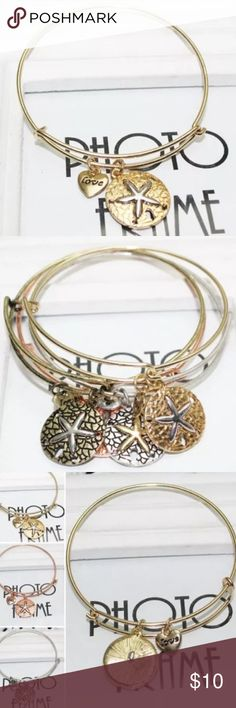Gold Starfish/Sand Dollar Bangle New retail gold starfish/sand dollar bangle. I currently only have gold available. Jewelry Bracelets