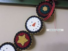 Handmade Penny Rug Garland Christmas Snowmen With Stars On Red And ... Possible crocheted garland idea.