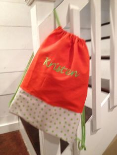 Cute with the matching green monogram!    Personalized and Monogrammed Orange with Green Polka Dot Cinch Sack - Drawstring Bag - Back Pack for girls. $26.00, via Etsy.