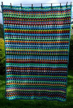 Shell Stitch Blanket, free pattern by Rachel Choi. Very easy, size totally adjustable. Can be done one color per row for a diamond effect like this one, or two rows each color to make a zig-zag effect.  Pattern is on Rachel's blog here http://www.crochetspot.com/crochet-pattern-shell-stitch-blanket/   . . . .   ღTrish W ~ http://www.pinterest.com/trishw/  . . . .    #crochet #afghan #throw