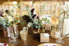 Lush green and gold table setting at Blue Valley Vineyard and Winery  Photo by Candice Adelle Photography