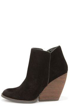"""With so many reasons to love the Very Volatile Whitby Black Suede Leather Wedge Booties, we can hardly keep our """"""""whits"""""""" about us! Genuine suede leather makes a sumptuous overlapping upper with a bit of oil-rubbing along the almond toe and heel, plus a curvy collar (with 10.5"""""""" circumference). #fashion #style #streetstyles #popsugar #wachabuy #apparel"""