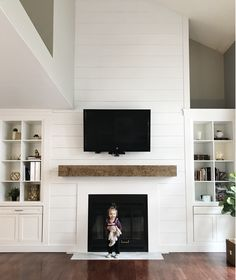 A high, amazing fireplace is the centerpiece of this space. Developer Judith Bali… – For the Home – fireplace Tall Fireplace, Shiplap Fireplace, Farmhouse Fireplace, Home Fireplace, Fireplace Remodel, Living Room With Fireplace, Fireplace Surrounds, Fireplace Design, My Living Room