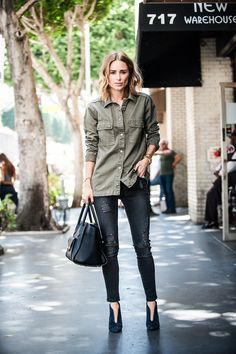 Anine Bing looks edgy and casual in this khaki button up, worn with distressed jeans and navy velvet heels. We recommend wearing a shirt such as this with jeans or leather trousers to get a similar look. Outfit: Anine Bing.