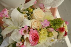#Spring #bridal #bouquet created with  #dahlias, #roses, #ranunculus, #lilies, #freesia, #Bells of #Ireland, #tulips    #Flowers by Elizabeth's Garden Santa Barbara, CA